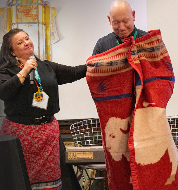 Jeff Tripician from Niman Ranch, and Dawn Sherman of Native American Natural Foods during a special blanket ceremony at the Edible Magazines Conference