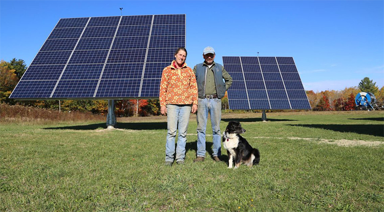 Jan and Rob Goranson with farm solar trackers-CEI